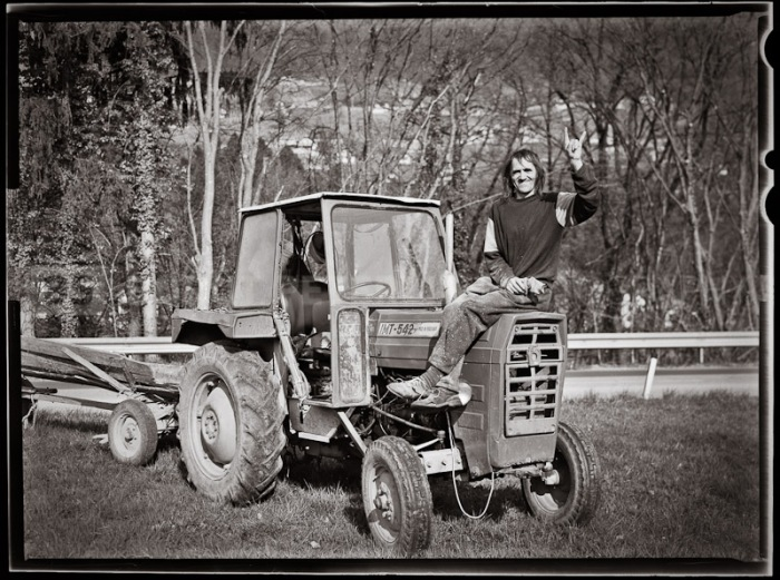 Brane Koncilja, a famous punker,  but now he's making a living as a lumberjack. He's still an anarchist, proud on his tractor IMT - Made in Yugoslavia