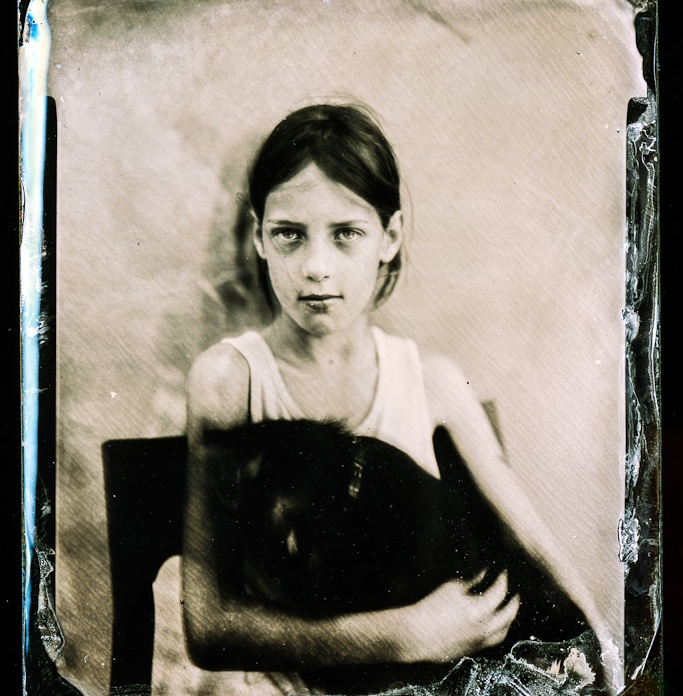 "My daughter Lučka, posing with a dog in her lap. Behind her her sister wants to scare her and make her move. Photographed with Linhof 135mm lens at f/3,5. Camera Shen Hao 4x5"". Wet Plate Collodion positive process. /////// Hčerka Lučka pozira s psico Luno v naročju. Za njo se skriva sestra, ki se trudi, da bi jo zmotila."