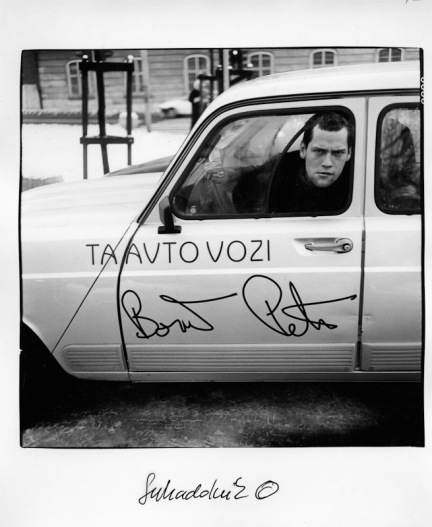 A portrait of myself from year 1998 by Jože Suhadolnik.  That's my first car, Renault 4. The sticker was real and it goes:  THIS CAR IS DRIVEN BY: and my signature.
