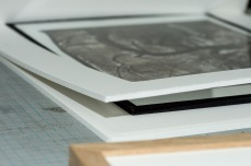 Here you can see two thick mats, the first one is framing the 6mm glass plates and the second one is backing the print.