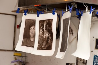 Carbon prints drying.